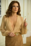 Sydney Prosser (Amy Adams) at the Plaza Hotel surveillance room in Columbia Pictures' AMERICAN HUSTLE. (Amy Adams blouse: vintage Halston, belt: vintage, skirt: made for film)